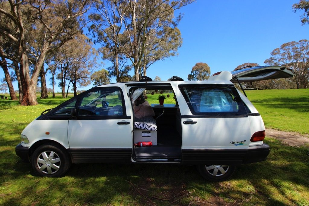 minivan outside backpacking around Australia