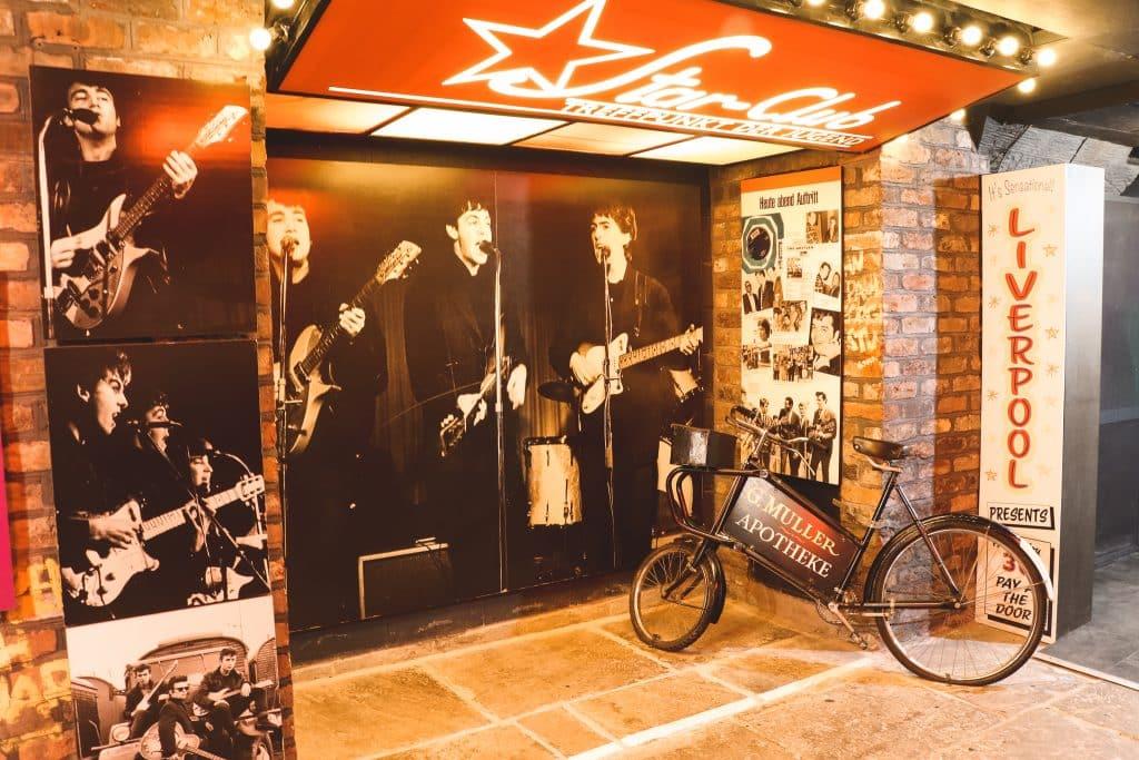 Muurposter van Beatles in Beatles Experience